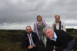 Paul Dennett and Tony Lloyd plant sphagnum watched by Anne Selby and Louise Morrissey on Little Woolden Moss