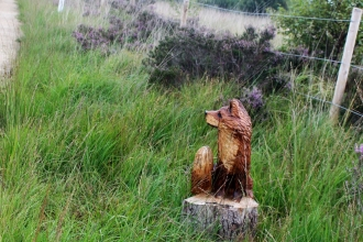 A wooden statue of a fox that was stolen from Little Woolden Moss in Manchester