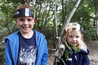 Two children wearing their crafts at Nature Tots at Heysham