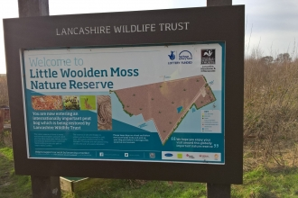 An information board at Lancashire Wildlife Trust's Little Woolden Moss nature reserve
