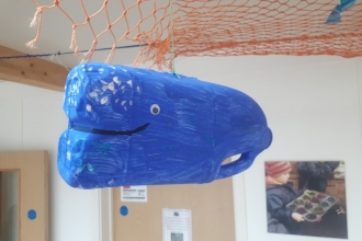 A whale 'Litter Critter' made from a waste milk carton