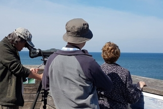 Visitors taking part in a Sea Watch at Rossall Point Observation Tower