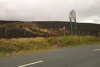 Scorched areas of Darwen Moor seen from the road after a fire