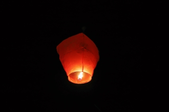 An orange fire lantern glowing in the dark