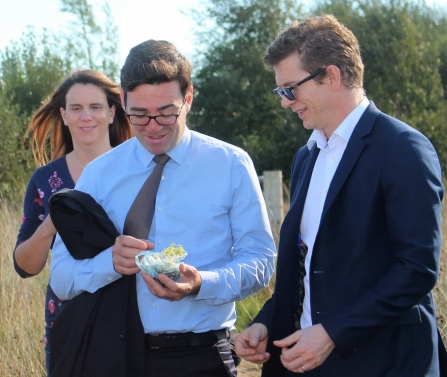 Andy Burnham and Chris Casey squeezing sphagnum moss on Little Woolden Moss