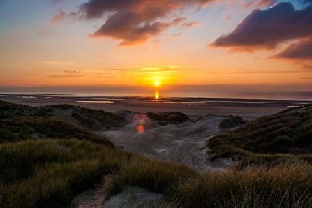 The sun setting in front of the Fylde sand dunes