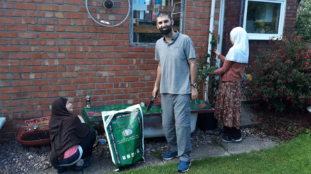 Ghazanfar Akram and family with their growing kit