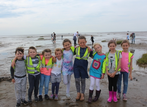 A group of children ready for mud dipping on St Annes beach