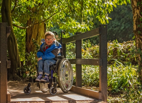 A child in a wheelchair visiting an accessible nature reserve